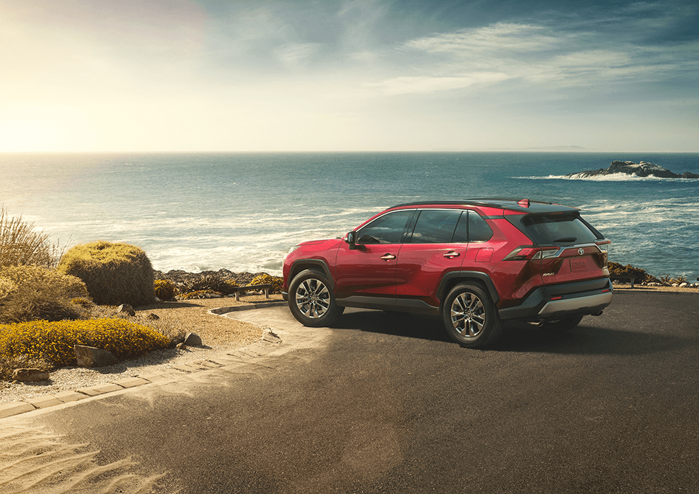 Red RAV4 Limited overlooking ocean